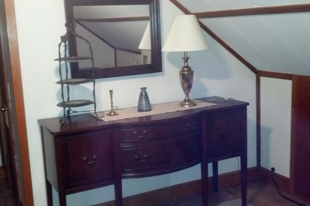 Antique buffet in room with antique lamp