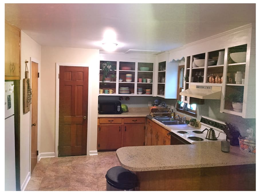 Kitchen! You're welcome to use any of our cutlery & cookware, just clean up after yourself. Note: no dishwasher or disposal.