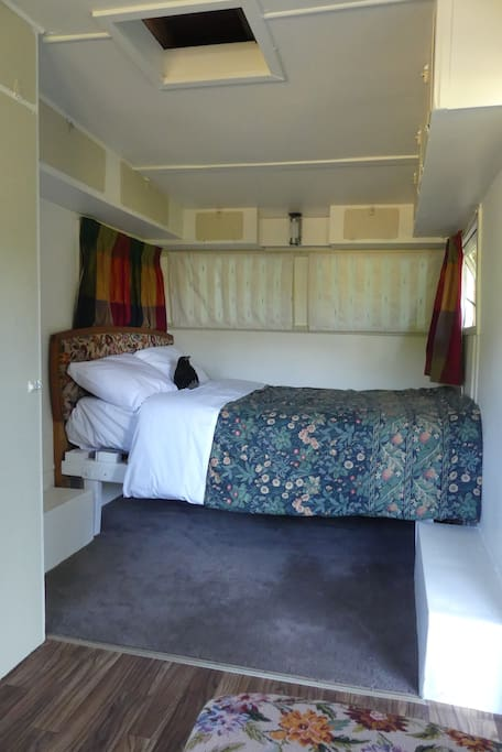 Comfy double bed in newly restored caravan.