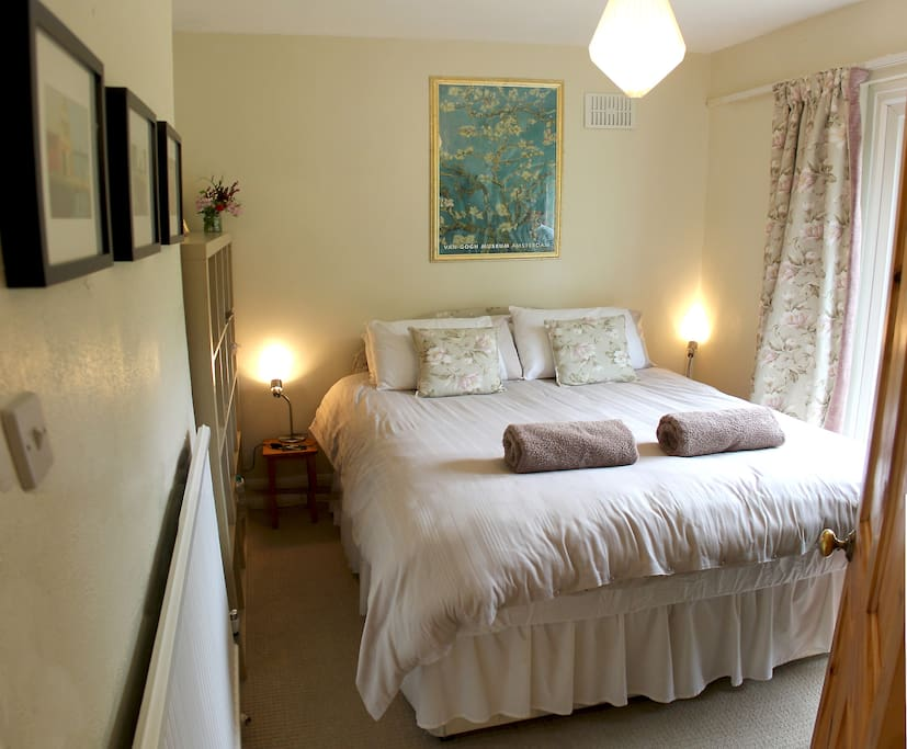 King sized bed in our ground floor bedroom with tea and coffee making facilities