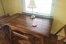 Table in extra room to use as a desk.