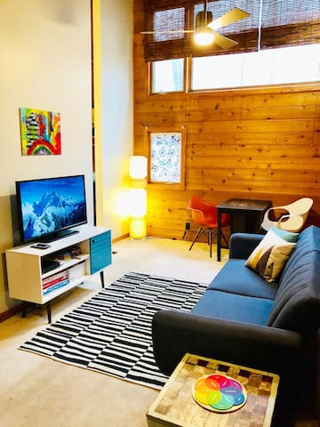 The loft! An awesome hangout space with a TV, extra seating, a bathroom and a sofa bed.