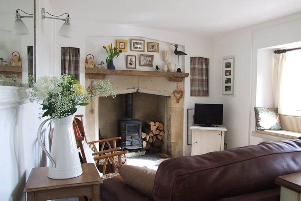 Living Room with original fireplace and wood burning stove