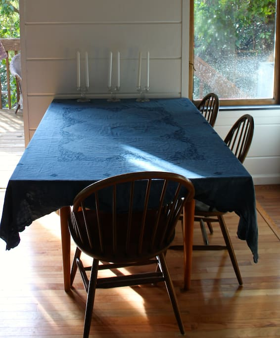 Russel Wright midcentury modern table with hand-dyed indigo tablecloth.