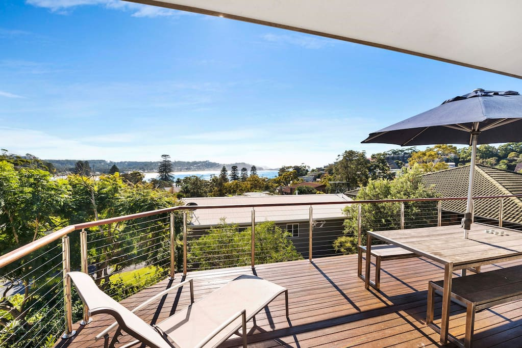 Enjoy views of the ocean on the back balcony and entertaining area