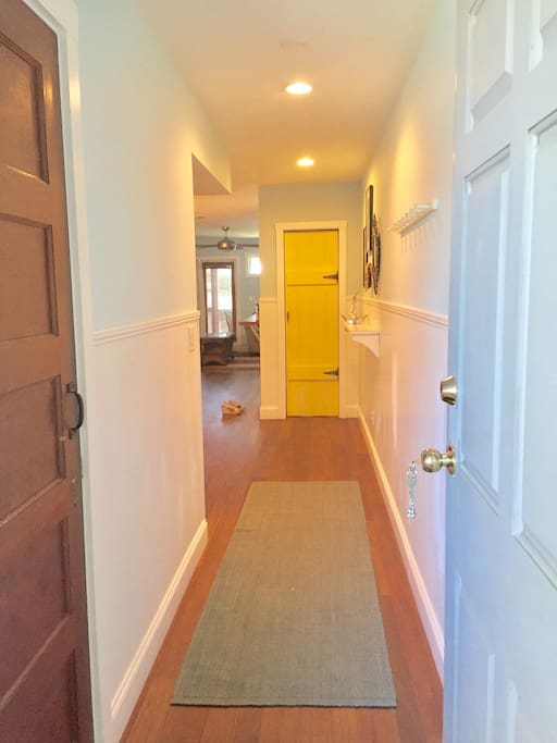 Front Door and Entryway. Downstairs half bath is on the on left after entering condo.