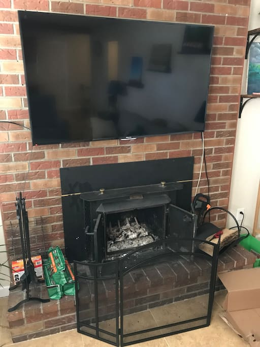 Wood burning fireplace and TV
