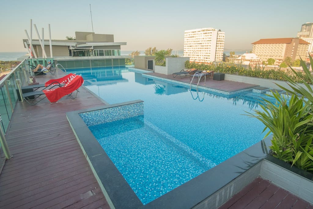 Large swimming pool with jacuzzi and sauna on the roof