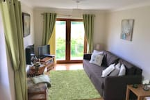 Lounge area with French doors looking out over the beautiful beacons mountain range including Fan Llia and Fan Nedd and down to the Black Mountains in the west. Bed settee, TV,DVD player and DVD's ,books and games .Electric fire .