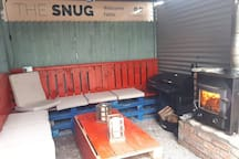 Beautiful and cosy private outdoor area to enjoy sitting by the stove or enjoying a BBQ