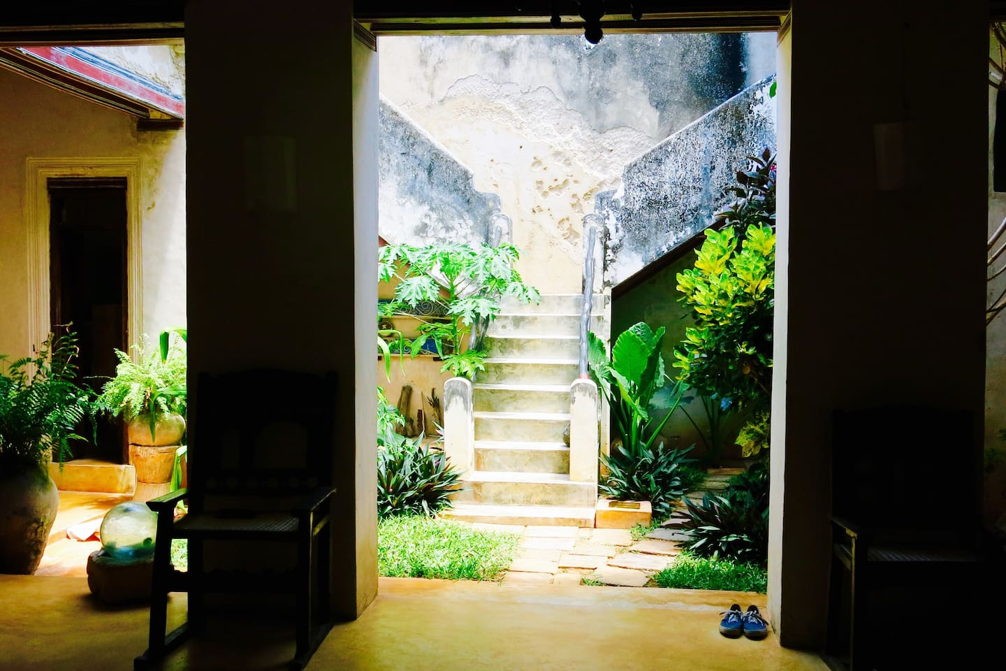 Double staircase from inner courtyard leading to Family Room at Madakani House
