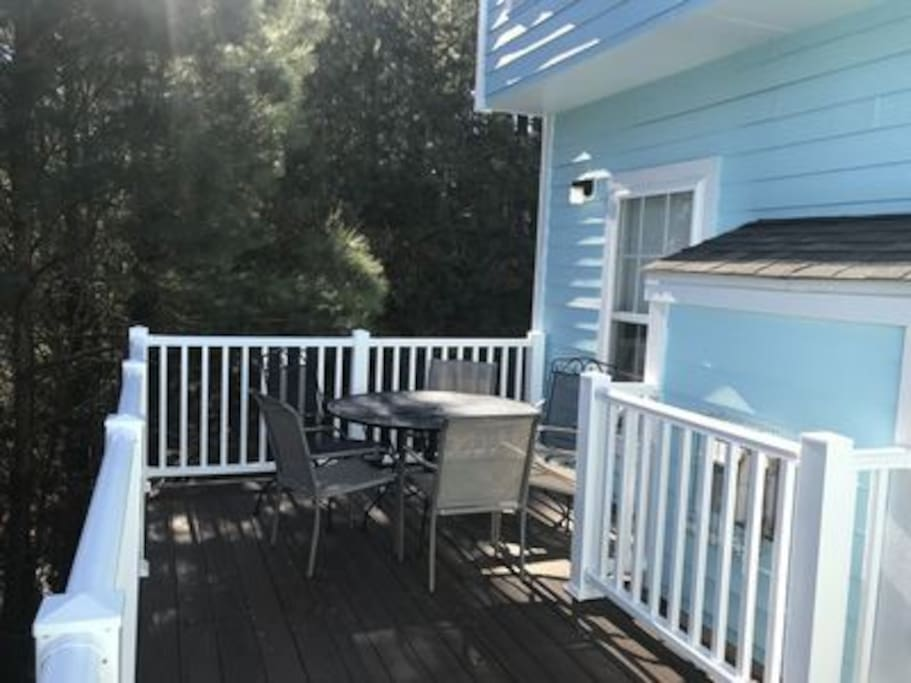 Private deck off living room fully enclosed by trees-perfect for enjoying crabs and drinks!