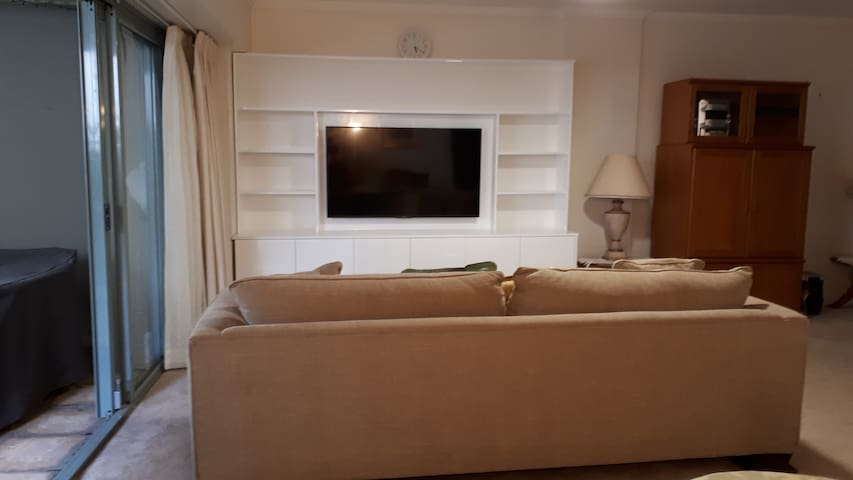 Open Plan Lounge Room with large LCD T.V. and Netflix.