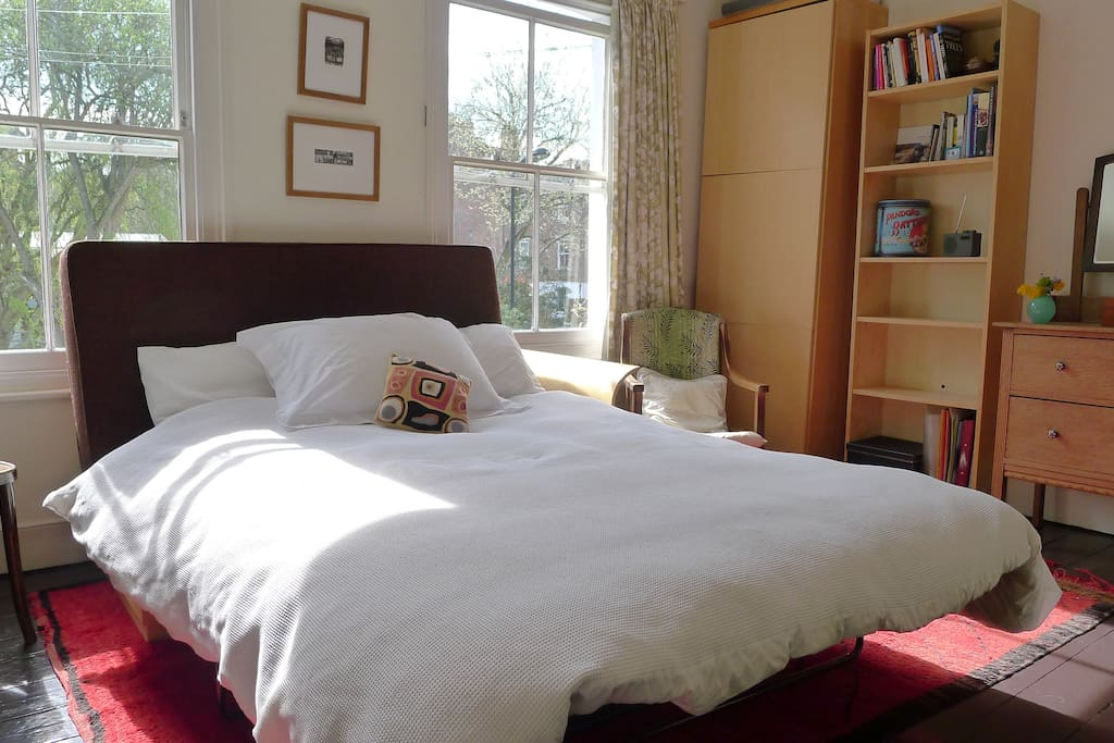 Comfortable double bed in light airy room