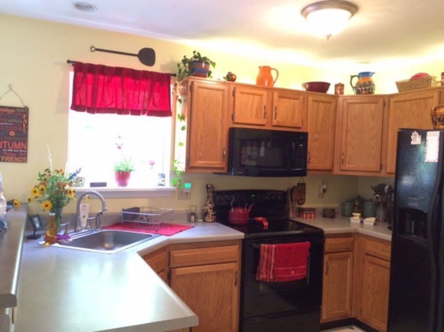 A bright and sunny  kitchen overlooks the backyard  , deck & pool area as well as the living room.  Great for socializing!