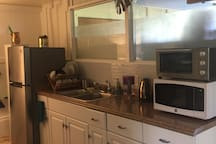 Kitchenette has full size fridge, sink, toaster oven, microwave, electric kettle and French press coffee maker.