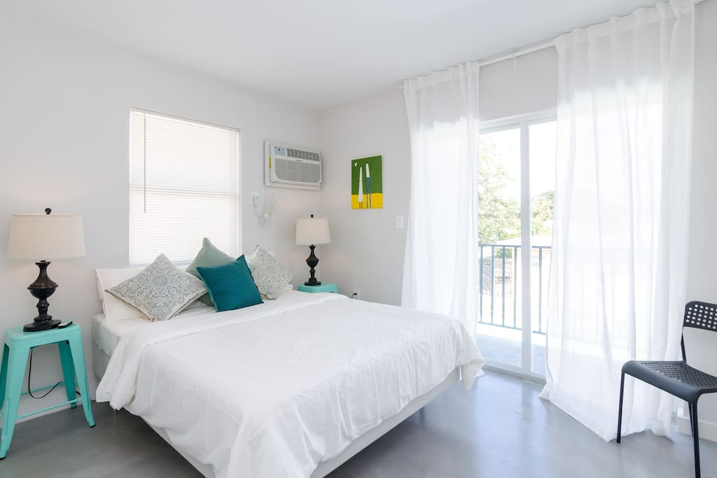 Queen Bed bedroom, decorated with love. We try to make our beds as comfy as possible with two pillows per person and a firm mattress. This bedroom leads to a balcony