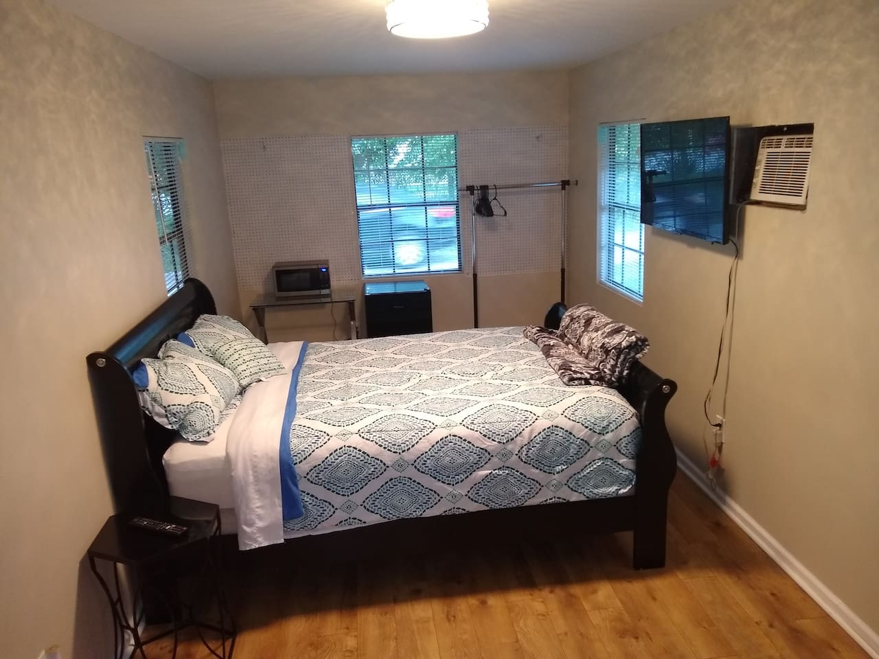 Room is spacious and well lit. However, all windows have blinds so those who don't enjoy the sun or desire privacy can close them.