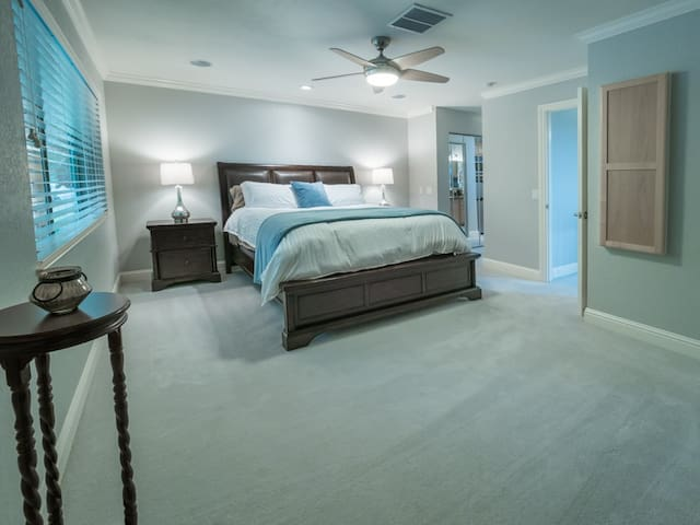 California King size bed, touch lighting on headboard, large spacious bedroom with mirrored closets, separate vanity area and heated flooring in master bathroom en suite.