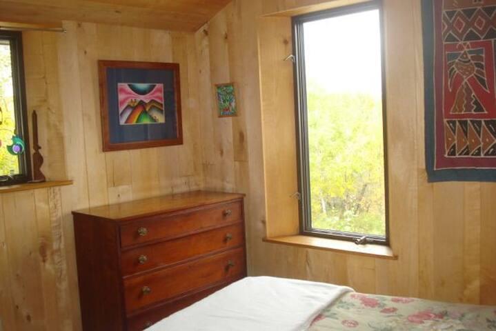 Bedroom with regular bed