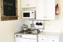 The kitchenette has a fridge, two burner cook top, sink and microwave. Please note there is NO OVEN.