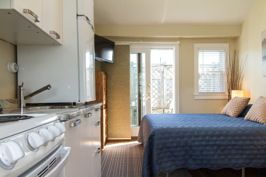 As you enter the condo the gorgeous kitchen, hardwood floors, and modern decor welcome you.