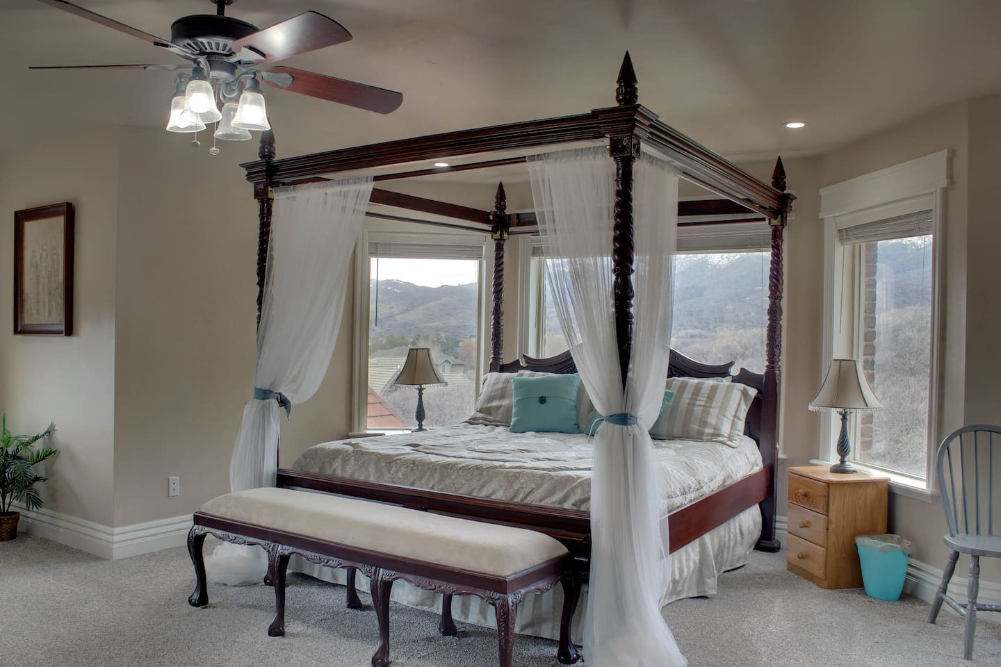 Master bedroom on the top floor with beautiful views of Lone Peak and surrounding hillsides and Alpine.