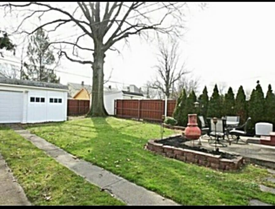 Fully equipped fenced-in back yard with grill, lighting and chimnea.
