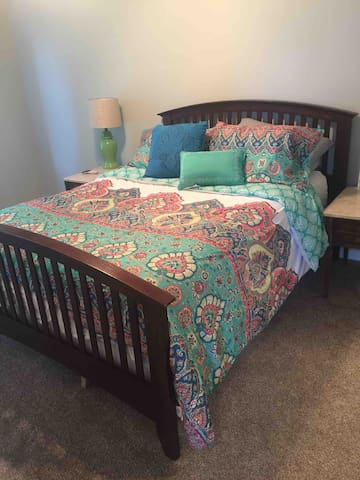 Upstairs queen bedroom suite with walk in closet, flat screen tv, and private bath.