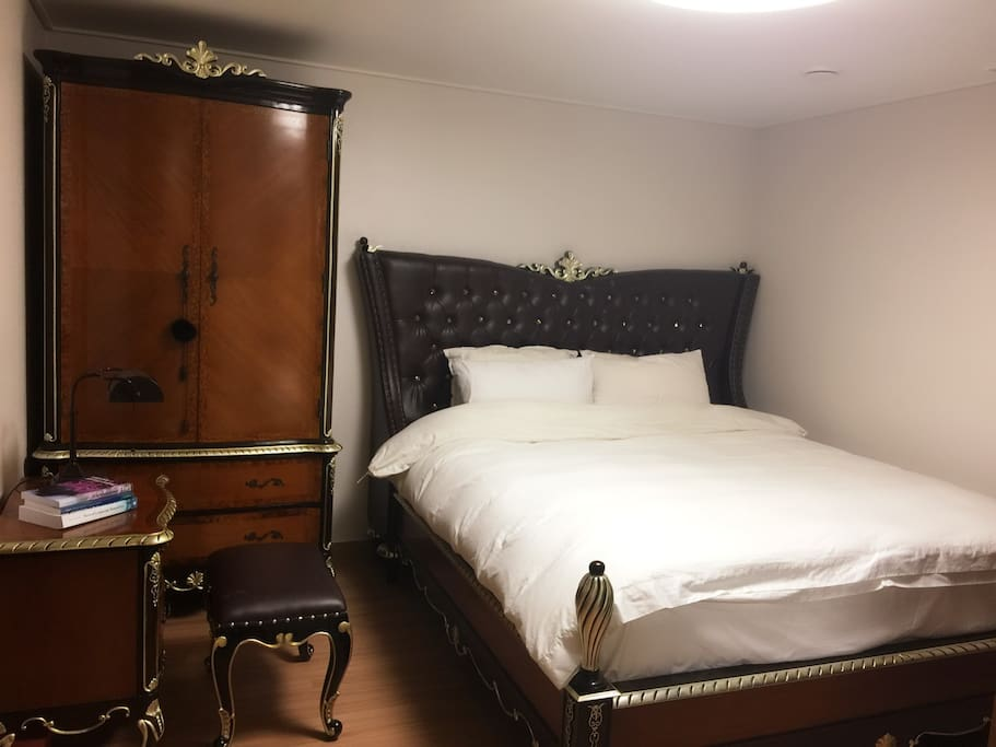 This is the bedroom furnished with antique-like bed and closet. It will give you very sweet comfort and relaxation.