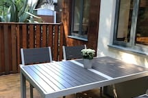 Private decking area with seating and gas barbecue, accessed via double doors from the lounge.  Additionally a further (communal) garden area is available with seating.