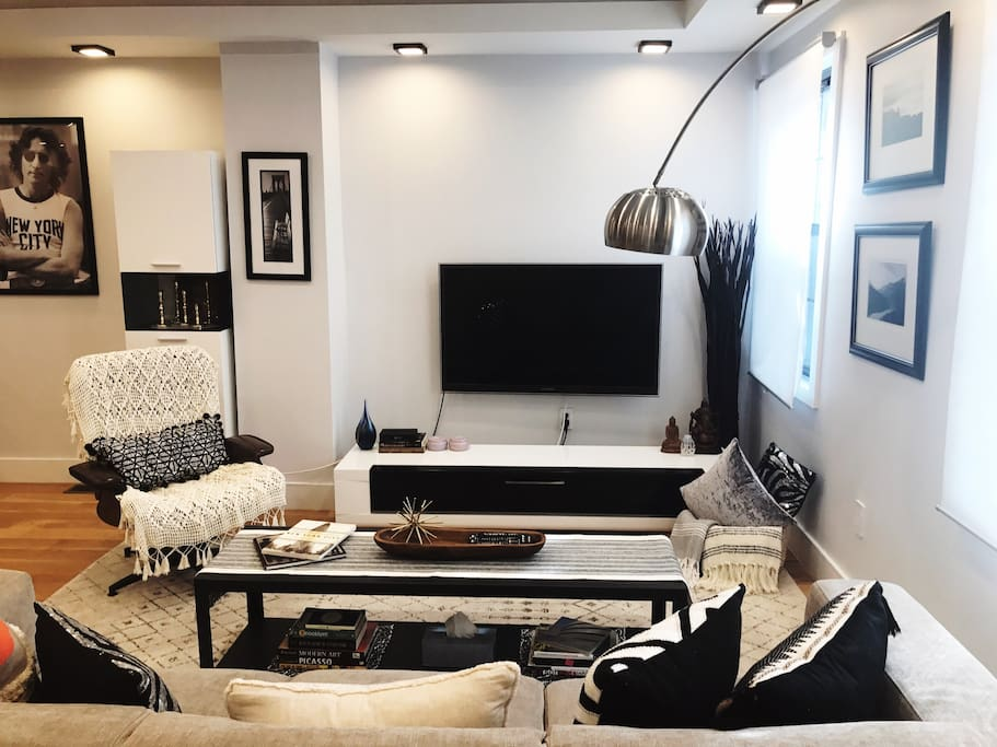 open concept living room/ 55 inch flat screen smart TV with 400+ HD channels + fast WIFI