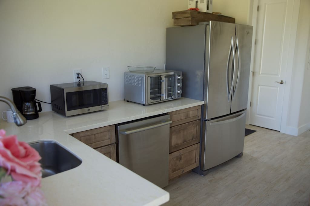 Kitchenette with toaster oven, refrigerator/freezer, microwave, coffee maker, and dishwasher