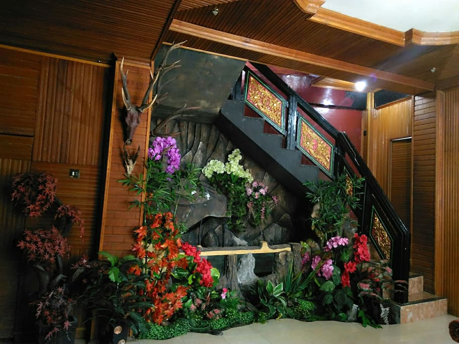 Beautiful living room with flower garden n fish pond