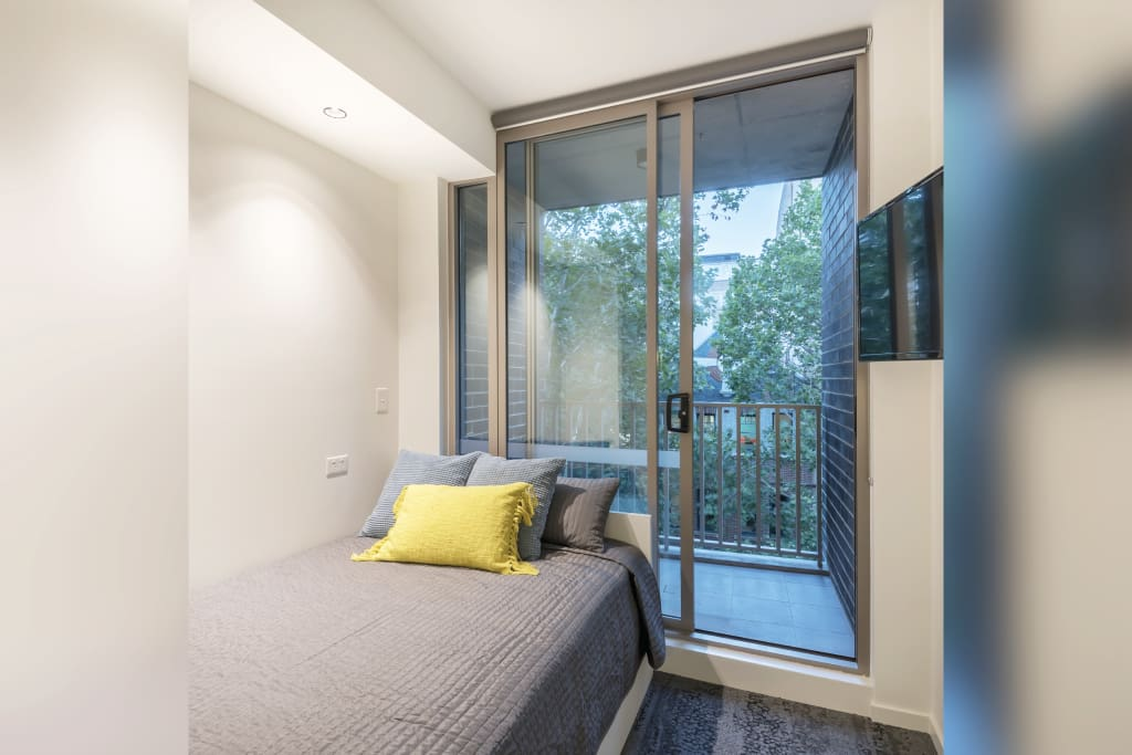 Bedroom with balcony overlooking Foveaux St