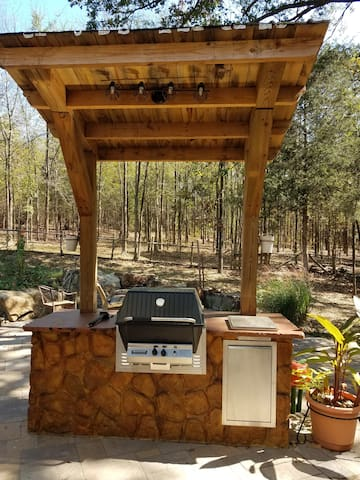 The patio with gas grill station and side burner.  Complete with electrical outlet and lights for your convenience.
