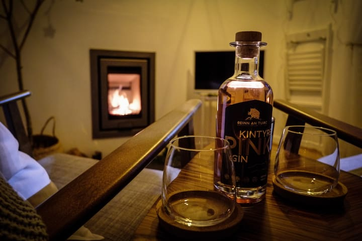 Pour a local Gin* (kintyre Gin is based at the Torrisdale Estate an 8 minute drive away) and enjoy by the fire, you can book a distillery tour from kintyregin.com  *Gin not supplied at the postbox