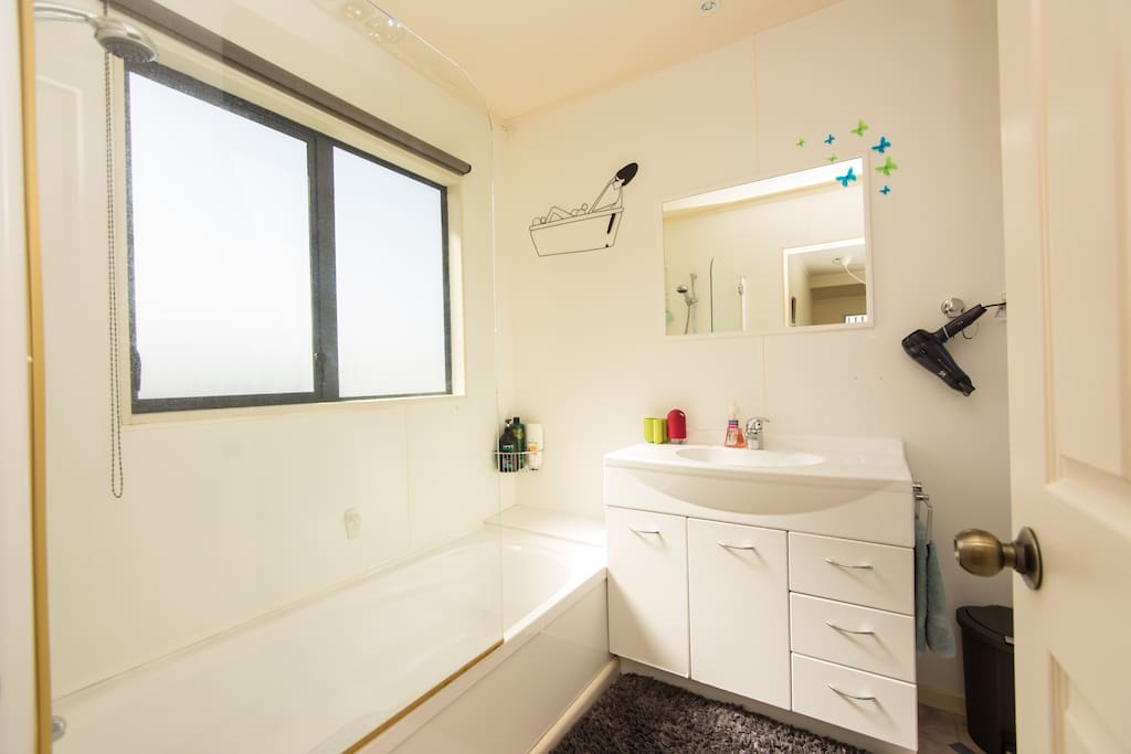 Private bathroom, with bath, shower, and toilet. Hairdryer and shampoo provided.