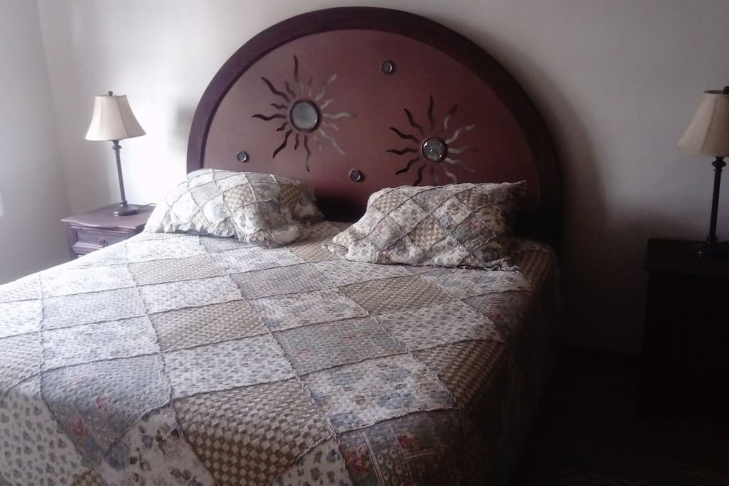 First bedroom with king size bed