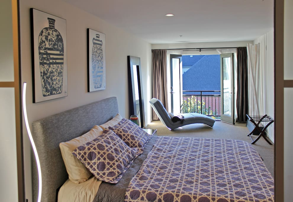 The spacious master bedroom suite occupies the entire top floor and features a king bed with a Tuft & Needle mattress and ample space for a Frontline Essential EZ Queen Bed for guests 7/8