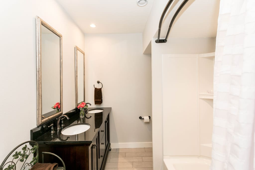 1st bathroom features a double vanity and a tub/shower