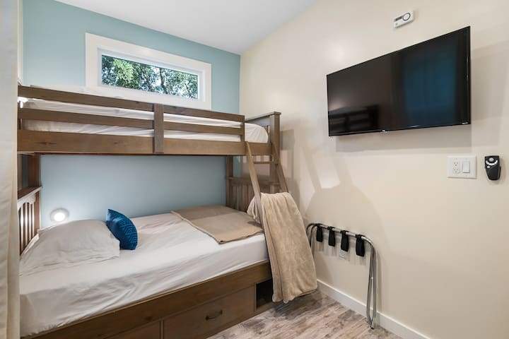 Bunk Bed Bedroom. 1 Twin Size Bed on top, 1 Full Size Bed in the middle, and 1 Twin Size Bed under.