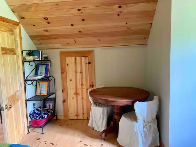 With two twin beds upstairs, there is a half bath