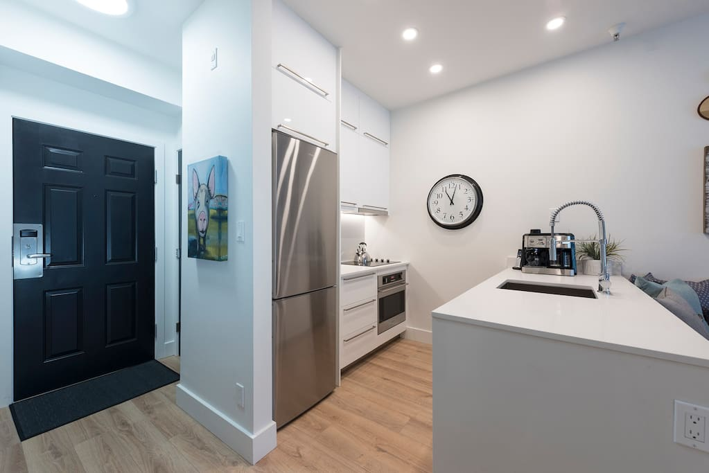 The kitchen features a full size dishwasher and an integrated microwave.
