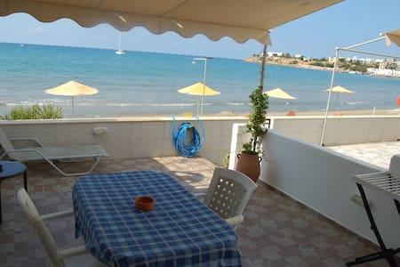 "Kamara apartment #6 ""On the beach of Makrigialos!"""