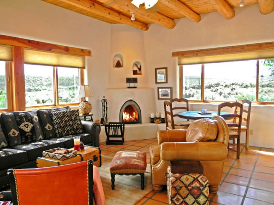Inviting living room with authentic wood burning kiva fireplace