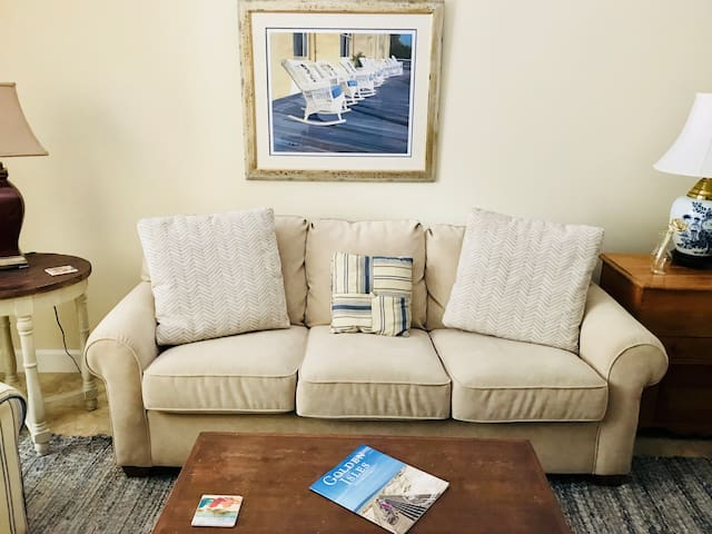 Living room. Take a seat and relax! UHDTV, cable, and internet