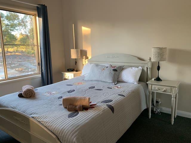 Ensuite bedroom with queen bed