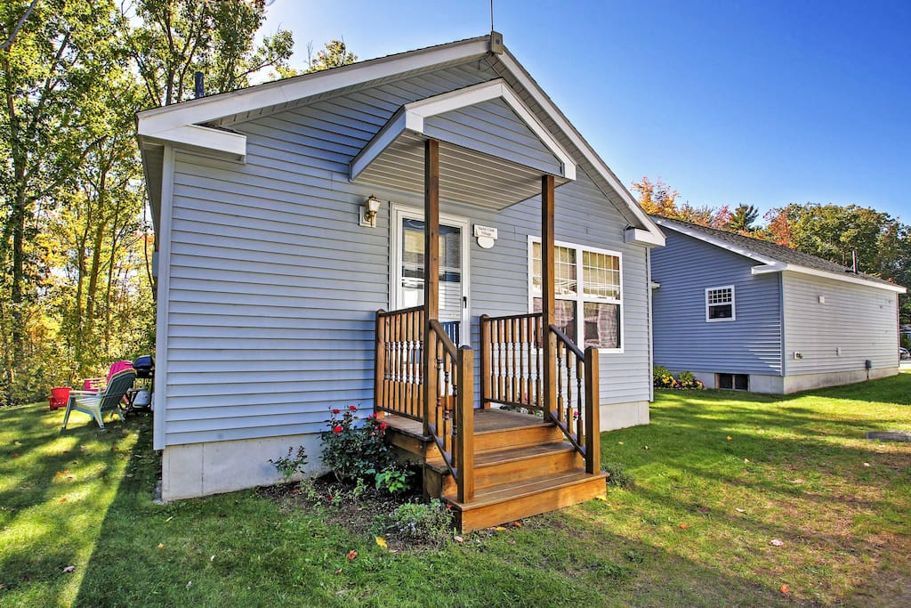 Upon arrival, the vibrant green grass will invite you right up to the lovely home.