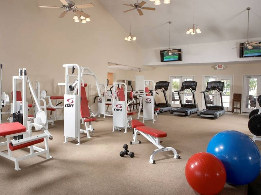Gym with Kitchen, Saunas, bathrooms, and outside pool area (2nd pool in complex)